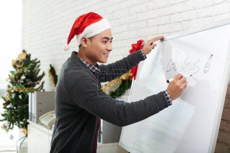 Businessman writing on white board