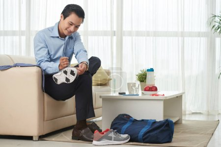 Businessman changing clothes for sport training
