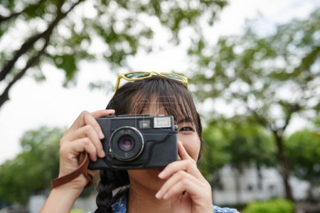 Girl taking photos with vintage camera