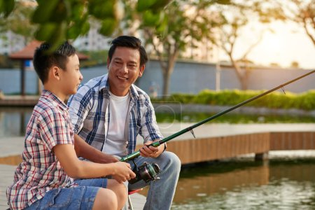 father and son having fishing