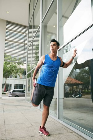 Asian man doing stretching exercises