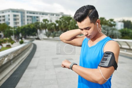 Man checking results after run