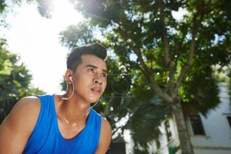 Vietnamese sportsman in headphones