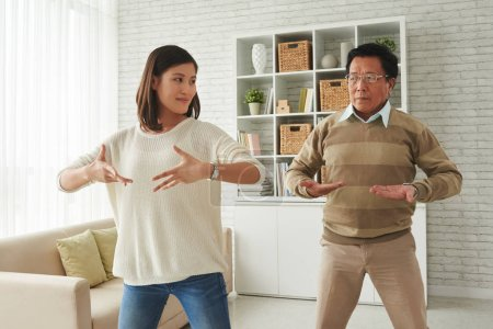 woman and her father doing breathing exercises