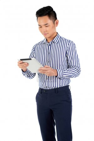 Financial adviser reading information on digital tablet