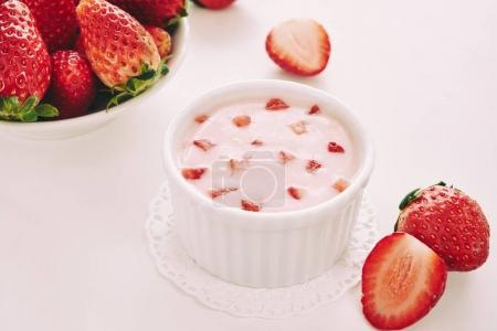 Cup of fresh tasty strawberry mousse on table