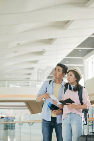 Young Asian couple waiting for departure in airport