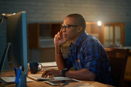 Handsome African American financial manager preparing annual accounts