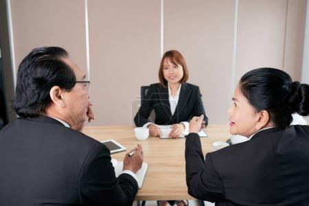 Business people discussing candidate at job interview
