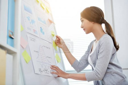 Photo for Pretty female managers analyzing data on various financial documents - Royalty Free Image
