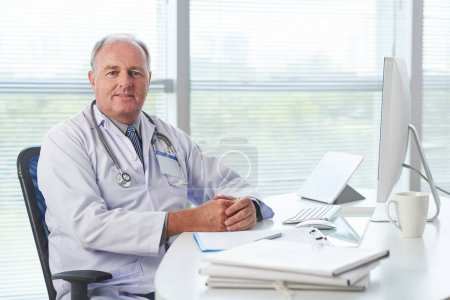 Portrait of confident general practitioner looking at camera