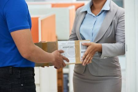 Cropped image of business lady receiving package