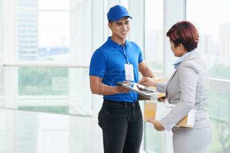 Business woman receiving package in office