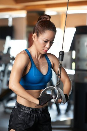 Vietnamese fit woman doing exercise for arms and back