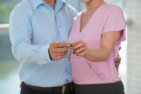 Photo for Married couple keys to their new house,selective focus - Royalty Free Image