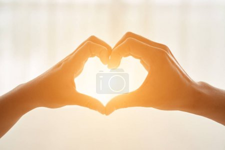 Photo for Couple making heart shape with their hands - Royalty Free Image