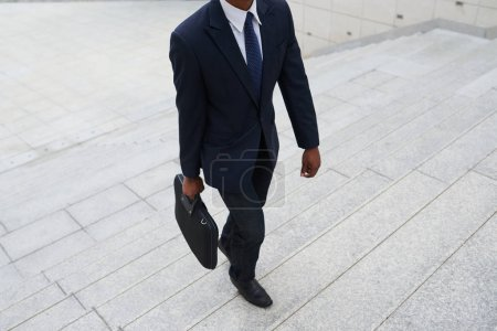 Photo for Cropped image of business person walking up the stairs - Royalty Free Image
