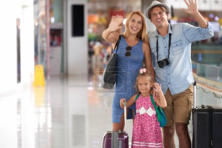 Father, mother and little daughter is ready to travel to another country