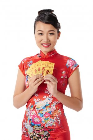 Portrait of Asian young woman holding greeting cards