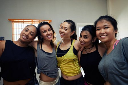 Photo for Beautiful multi ethnic women posing and looking at camera in dance studio - Royalty Free Image