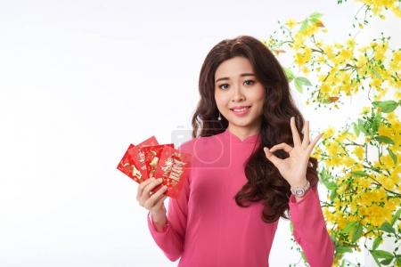 Lovely young woman wishing you great Chinese New Year celebration