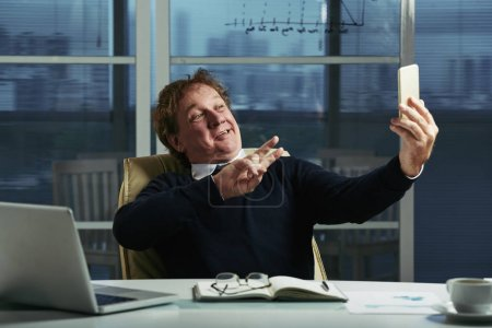 Entrepreneur taking funny selfies at his workplace