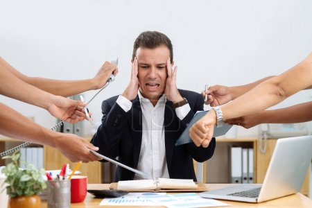 Businessman having panic attack because of many tasks given to him