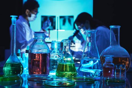 Glassware with various liquids and reagents in laboratory