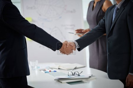 Photo for Close-up image of business partners shaking hands to greet each other - Royalty Free Image