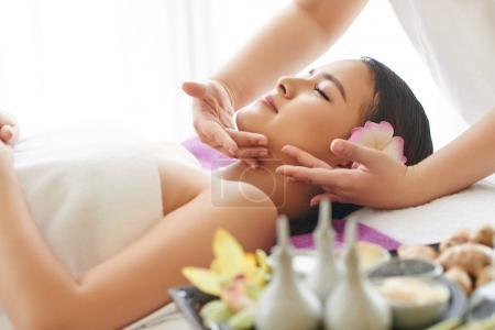 Vietnamese young woman getting spa treatment in spa salon