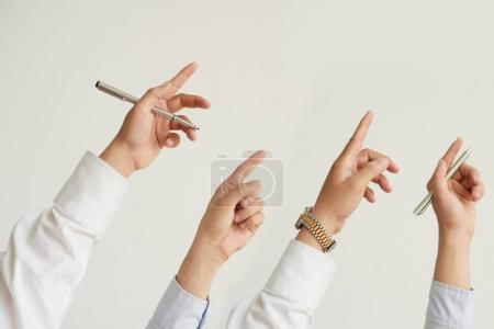 Photo for Hands of business people pointing up with index fingers - Royalty Free Image