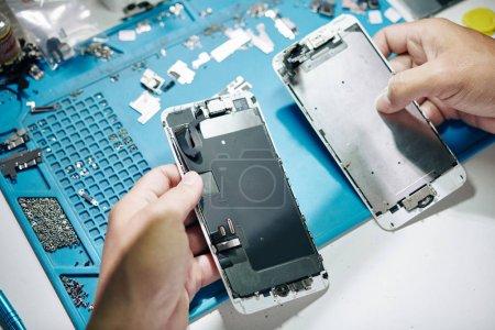 Photo for Hands of repairman replacing broken screen of smartphone - Royalty Free Image
