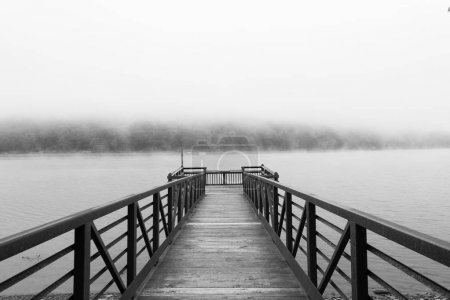 Early in the morning, just after sunrise, on the Allegheny river, located in Pennsylvania. The fog is near the surface of the reservoir appearing as low clouds. The platform is centered in the frame,