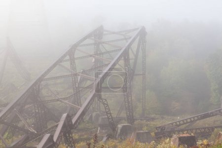 Mangled metal framework from the Kinzua bridge. The kinzua bridge used to be the tallest and longest railroad structure for trains. Part of it collapsed after a tornado hit it.