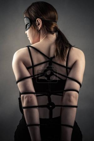 sexy woman in mask and bondage hands