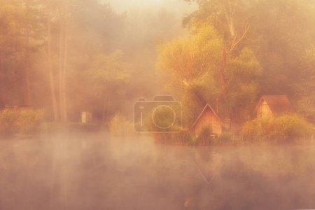 Gorgeous small fishing pond in dense thick fog