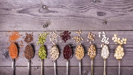 Photo for Composition of dry legumes of different types, color and flavor on rustic wood background - Royalty Free Image