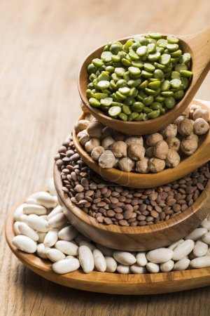 Photo for Composition of dry legumes of different types, color and flavor in the foreground - Royalty Free Image