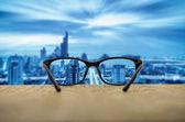 cityscape focused in glasses lenses
