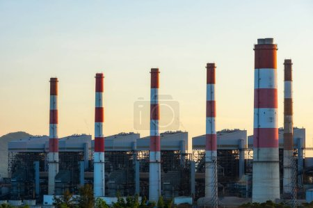 Photo for Aerial view of coal-fired power plants in a large area The machine is working to generate electricity. Beautiful evening sky, Mae Moh, Lampang Province, Thailand. - Royalty Free Image