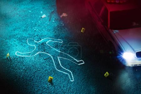 Photo for Crime scene with body outline, evidence markers and a police car with dramatic lighting - Royalty Free Image