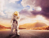 Astronaut standing on a road