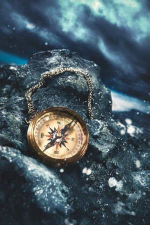 compass on rocks with a dark sky