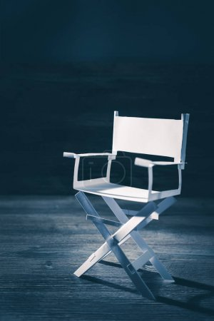 paper director chair on a blueish grey background