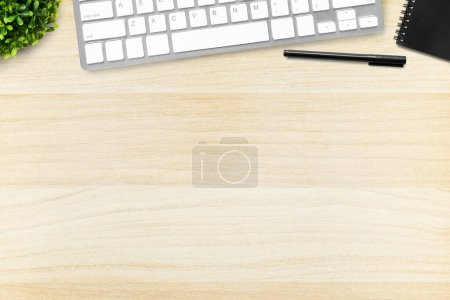 Photo for Wood office desk table with computer keyboard, pen and notebook. Top view with copy space, flat lay. - Royalty Free Image