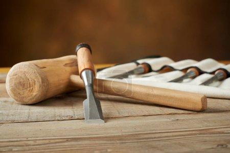 woodworking tolls, chisels and mallet on workbench
