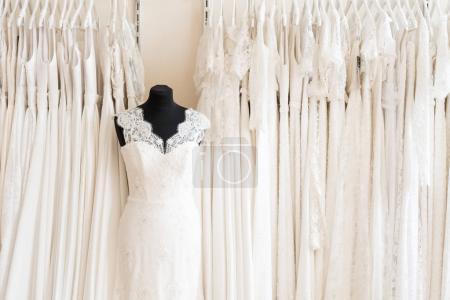 beautiful white fashion dress on black manikin at wedding salon