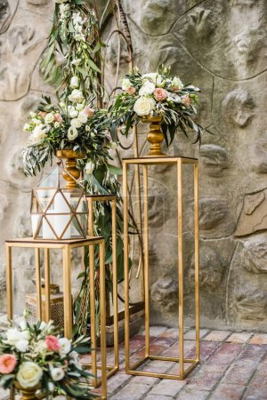 Floral wedding decoration with fresh pastel flowers and candles