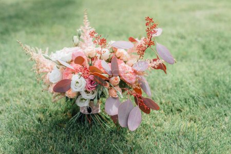 Wedding bouquet with spring flowers on green grass