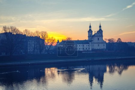 Church on the Skalka at sunrise in old town in Krakow with reflection in the river, Poland